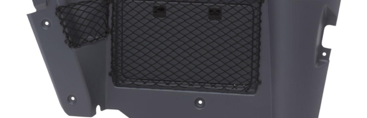 Cab interior trimming with fuse box door